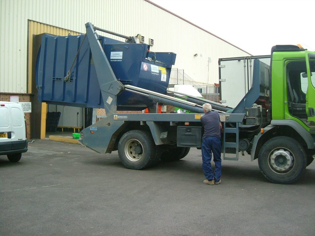 Compactor being removed