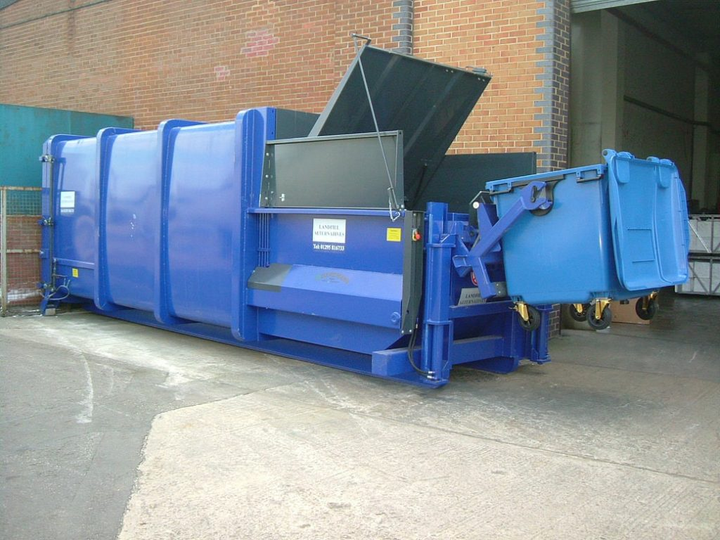 Portable compactor with bin lift