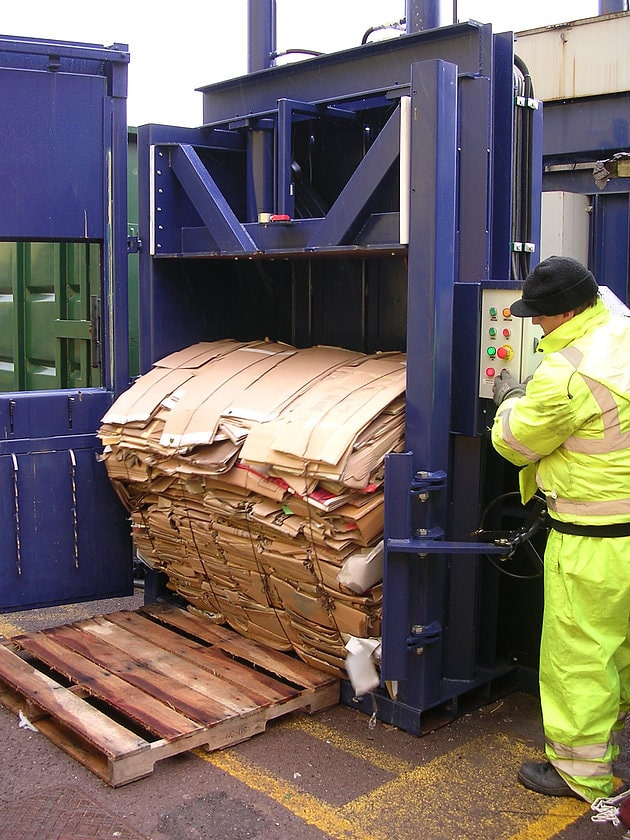 Man operating Vertical Baler